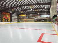 We traveled to Kapolei, Hawaii and inside to resurface two inline skate hockey rinks with Versacourt Speed Indoor tile. This is a portion of the completed first rink, including some of the lines.