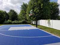 Blue and silver backyard basketball court in North Attleboro, MA.
