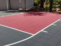 Residential slate green and red basketball court in Norwell, MA.