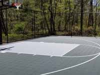 Backyard basketball court, in Versacourt slate green and titanium, in Stow, MA.