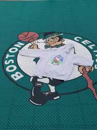 Custom Celtics logo wearing a BCM logo sweatshirt on a basketball court installed in Swampscott, MA.