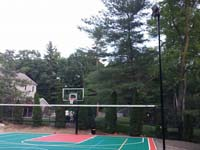 Backyard basketball court in Pembroke, MA. Whatever your sport, you could have a court surface and accessories of your own in Westford, Billerica, Wilmington, Tewksbury or Chelmsford.