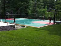 Backyard basketball and tennis surface, hoops, lights, adjustable net, and rebound fence in Pembroke, MA.