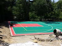 Backyard basketball courts like this multi-sport surface in Pembroke, MA can be yours in greater New England and, in professional sizes, the Caribbean.