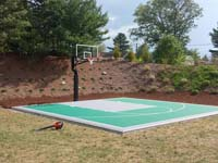 Bridgewater, MA courts a sport surface in emerald green and titanium low impact tiles in a yard like yours.