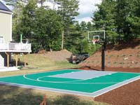 Residential basketball court with emerald green and titanium Versacourt surface in Bridgewater, MA.