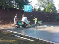 Slab being poured and smoothed for pending install of home basketball court in Bridgewater, MA.