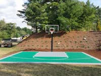 Emerald green and titanium Versacourt quality backyard basketball court in Bridgewater, MA.