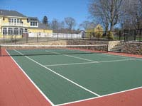 Large rust red and green tennis court in Newport, RI, on Aquidneck Island..