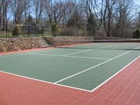 Residential rust red and green tennis court installation in Newport, RI.
