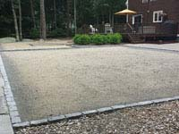 Packed surface ready for base and basketball court installation integrated with patio Dartmouth, MA