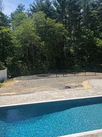 Before picture overlooking pool toward bare area of yard where blue and gray residential basketball court in Easton, MA will be.