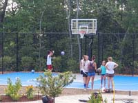 Friends at new backyard basketball court in Easton, MA.