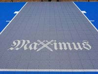 The name Maximus with crossed swords for the X, in honor of the court owner's son.