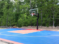 A court like this could be yours, but this sunny blue and red basketball court belongs to someone in North Attleboro, MA.
