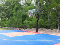 Focus on red key and basketball goal system on North Attleboro, MA cour.