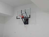 Basketball hoop installed inside a garage.