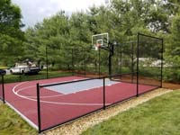 View of red and silver personal basketball court in Groton, MA.