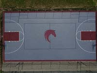 Overhead view of entire Great Horse basketball court with horse head logo in center.