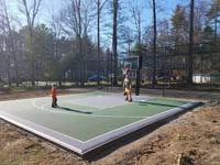 Backyard basketball court and batting cage in Hanover, MA.