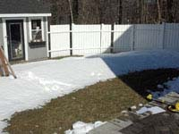 Planning started in winter, snow still on the ground, for this small black and red hingham basketball court.