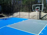 Home sport court in Lakeville, MA made with light blue and ice blue Versacourt tile colors.
