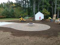 Detail work around basketball court featuring Celtics logo, with fire pit, patio, and light for night play, in Londonderry, NH.