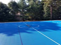 Large royal blue and titanium basketball court with golf seahorse logo at Bay Club in Mattapoisett, MA.