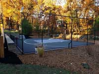 Beautiful late autumn home basketball court installation designed to fit neatly into the landscape in an undisclosed Massachusetts location. Update: It's Westford, MA.