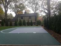 Custom rounded backyard basketball court in Needham, MA.