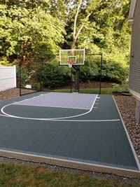Slate green and titanium basketball court in Needham, MA.