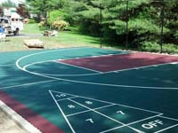 Backyard basketball court in Kingston, MA, featuring shuffleboard and tennis.