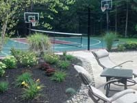 Backyard multicourt in Kingston, MA, featuring basketball, tennis, and shuffleboard.