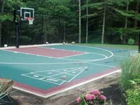 Slate and burgundy backyard basketball court in Kingston, MA.