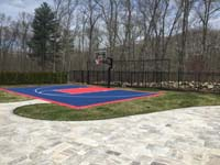 Navy blue and red New England home basketball court shown after associated landscape improvements were complete in North Attleboro, MA.