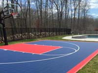 Home court for sports like basketball in North Attleboro, MA, featuring navy blue and red Versacourt game tiles.