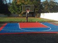 Sport and game courts can go on existing driveway or other asphalt surface. Shown is a small blue and orange driveway basketball court in southeastern Massachusetts.