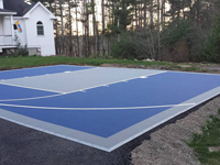 Blue tile court on a South Shore driveway in Massachusetts.