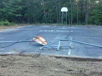 Destroyed Parsonage Road public basketball court in Plympton, MA before restoration.