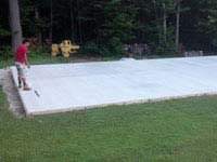 Cement has been poured and cured for a graphite and olive green court in Raynham, MA.