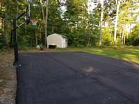 Asphalt court waiting for addition of jade green and blue Versacourt basketball tile in Rehoboth, MA.