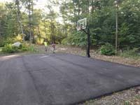 Blacktop court waiting to be improved with jade green and blue Versacourt low impact basketball tile Rehoboth, MA.