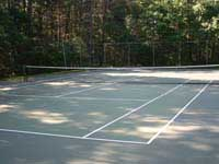 Run down commercial tennis court and multicourt at apartments or condos in Duxbury, MA.