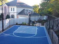 Backyard basketball court in Stoneham, MA. Whatever your sport, you could have a court surface and accessories of your own in West Roxbury, Allston, Chestnut Hill, Winchester or Concord.