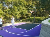 Backyard basketball court taking advantage of a small, unused spot in Stoneham, MA.
