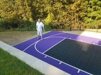 Purple and black backyard basketball court in Stoneham, MA.