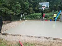 Backyard basketball court construction in Stoneham, MA.