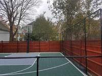 Backyard basketball court is the sort of thing you might find in Wakefield, MA or a yard like yours.