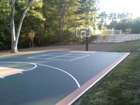 Walpole, MA backyard basketball court installed on asphalt.