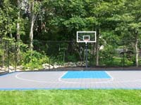 Graphite and light blue backyard basketball court installed in West Bridgewater, MA.